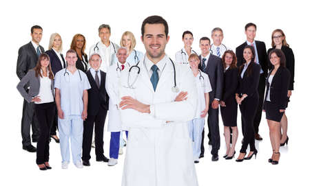hospital staff: Hospital staff represented by both the medical profession in the form of a doctor and the business administrators Stock Photo