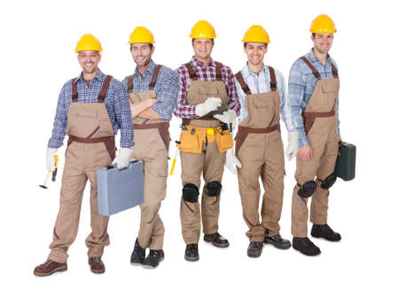 Portrait of happy industrial workers team. Isolated on white photo
