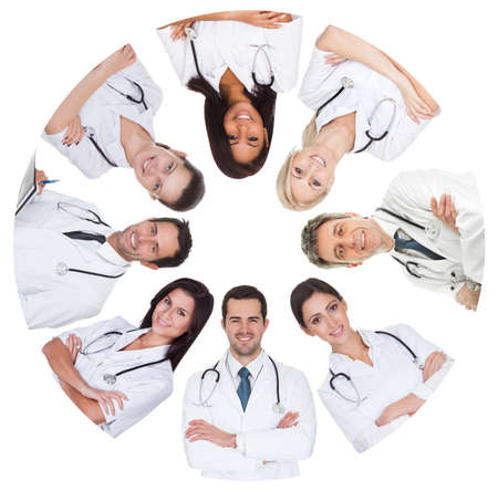 Low angle view of diverse group of doctors. Isolated on white photo