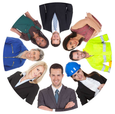 hard workers: Low angle view of diverse professional group. Isolated on white