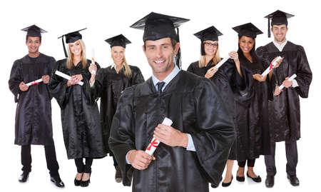 laurea: Gruppo di studenti laureati. Isolati su bianco Archivio Fotografico