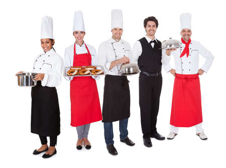 Group of restaurant chef and waiters. Isolated on white photo