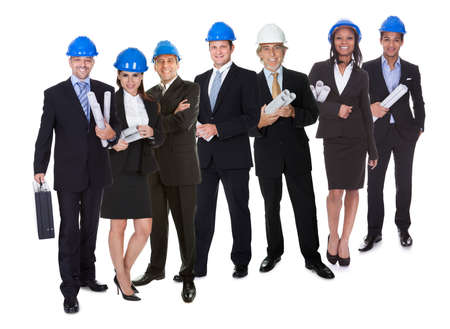 Portrait of happy architect offering handshake and his team. Isolated on white photo