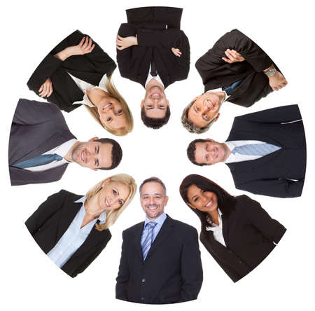 Low angle view of diverse group of business people. Isolated on white photo