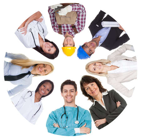 Low angle view of diverse professional group. Isolated on white photo