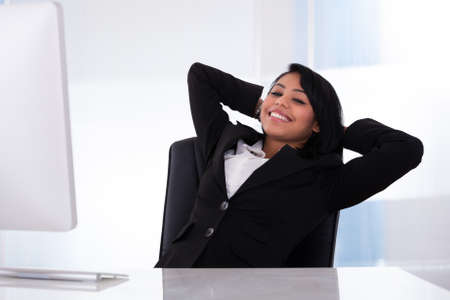 Portrait Of Young Businesswoman Relaxing In The Office photo