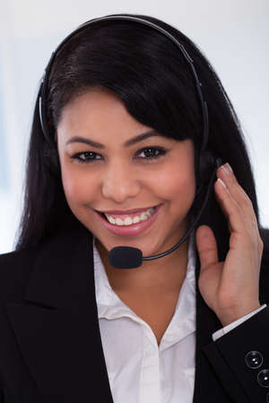 Close-up Of Happy Young Female Customer Representative Stock Photo - 19632398