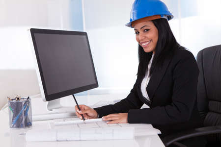 Portrait Of Happy Female Architect Working In Office Stock Photo - 19632343
