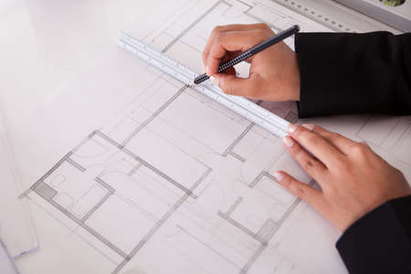 Closeup Of Female Architect's Hands Making Blueprints photo