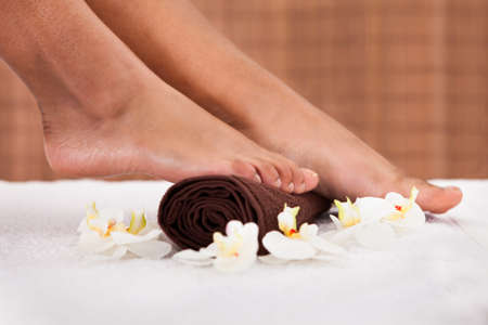manicure woman: Close-up Of Human Foot Getting Aroma Therapy Stock Photo