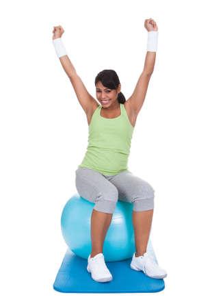 Woman Exercising On Pilates Ball Over White Background Stock Photo - 19632452