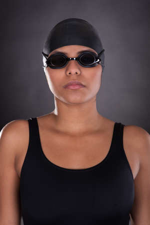 swimmers: Portrait Of Young Female Swimmer Isolated Over Black Background