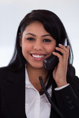Portrait Of Young Businesswoman Talking On Telephone Stock Photo - 19791933