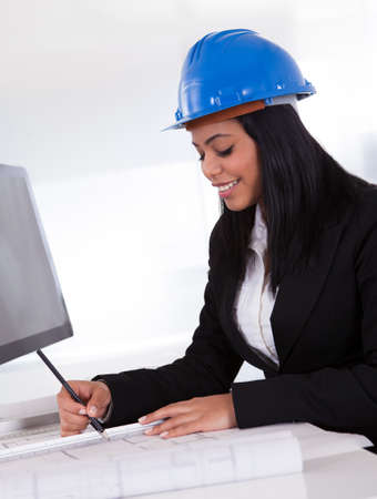 Portrait Of Happy Female Architect Working In Office Stock Photo - 19791867