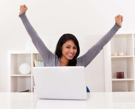 Portrait Of Excited Happy Young Woman Using Laptop Stock Photo - 19791983