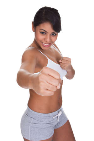 girl punch: Young Attractive Female Punching Over White Background Stock Photo