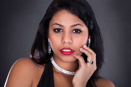 Young Beautiful Woman Wearing Diamond Jewelry Over Black Background photo