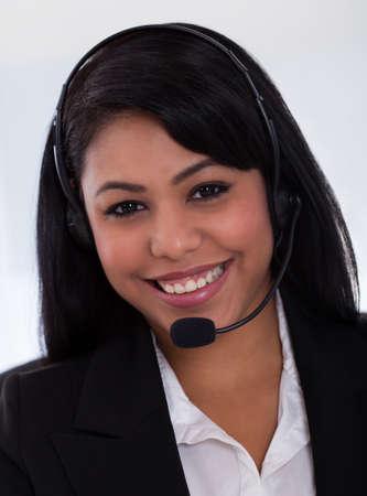 customer service phone: Close-up Of Happy Young Female Customer Representative