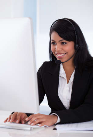 Portrait Of Female Customer Representative Using Computer Stock Photo - 19979795