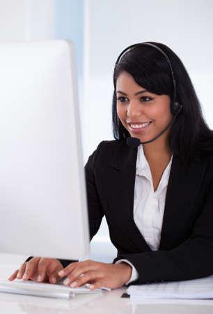 Portrait Of Female Customer Representative Using Computer Stock Photo - 19979795