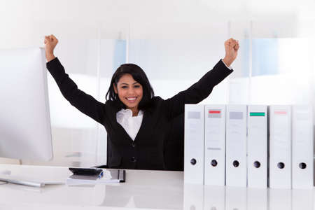 completed: Portrait Of Happy Businesswoman With Hand Raised