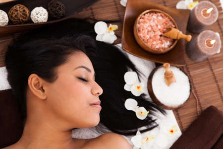 Young Woman With Her Eyes Closed Relaxing In A Spa photo