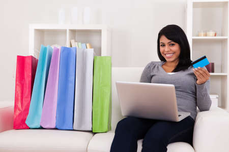 Young Woman Shopping Online With Shopping Bags photo