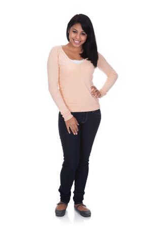 personas de pie: Retrato de mujer joven aislado m?de fondo blanco Foto de archivo