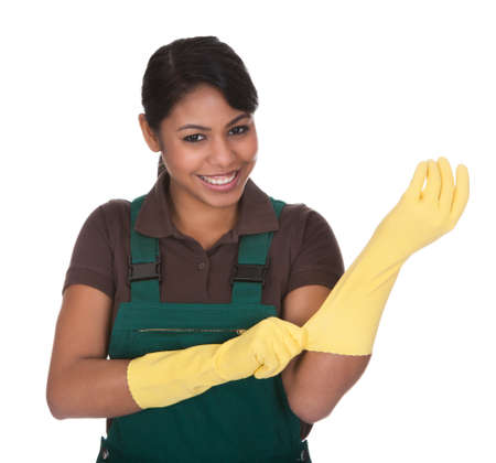 gumboots: Young Female Gardner Wearing Gloves Over White Background