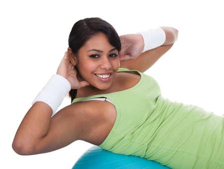 Woman Exercising On Pilates Ball Over White Background Stock Photo - 19979676