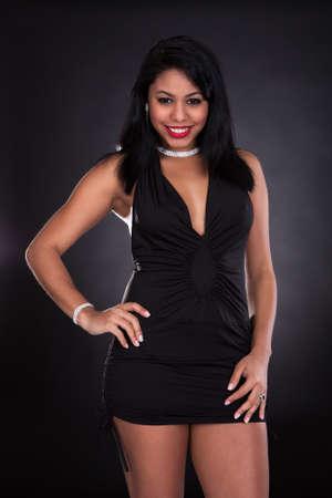 exuberance: Portrait Of Young Beautiful Woman In Elegant Dress Stock Photo