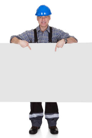 jumpsuit: Technician Holding Blank Placard On White Background