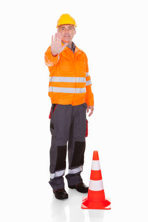 traffic cone: Man Showing Stop Sign Over White Background Stock Photo