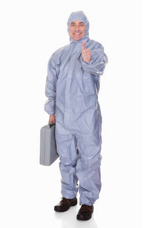 jumpsuit: Mature Man With Protective Wear And Thumb Up Isolated Over White Background Stock Photo