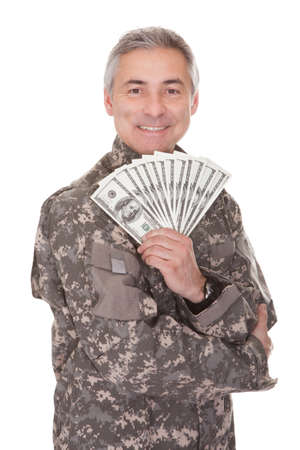 fatigues: Happy Mature Soldier Holding 100 Dollar Bills Isolated On White Background