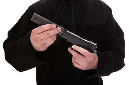 attaching: Close-up Of A Man Attaching Silencer To Handgun Stock Photo
