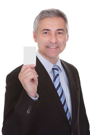 Portrait Of Mature Businessman Isolated Over White Background photo