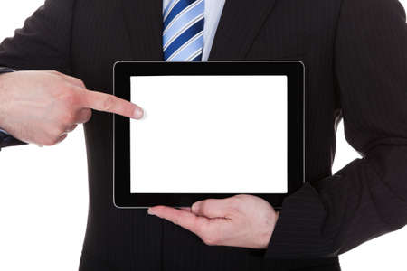 Mature Businessman Showing Digital Tablet Over White Background photo