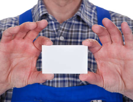 Mature Male Technician Holding Visiting Card Over White Background photo