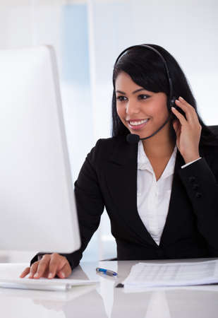 computer centre: Portrait Of Female Customer Representative Using Computer