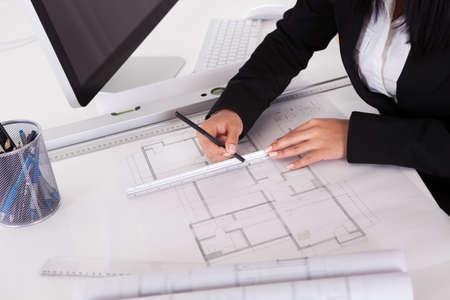 Closeup Of Female Architect's Hands Making Blueprints Stock Photo - 20076953