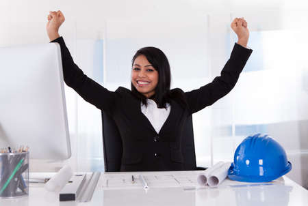 Portrait Of Young Excited Female Architect With Hand Raised Stock Photo - 20076722