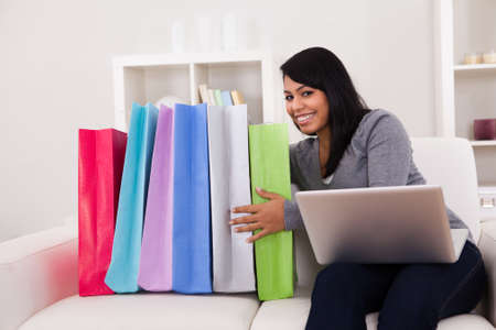 Young Woman Shopping Online With Shopping Bags Stock Photo - 20076666