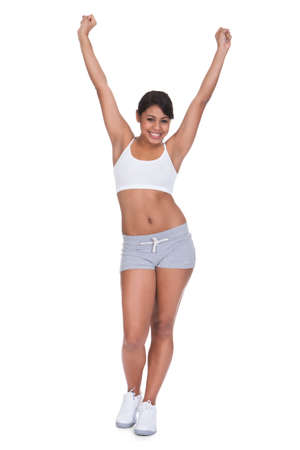ordinary: Young Happy Woman Exercising Over White Background