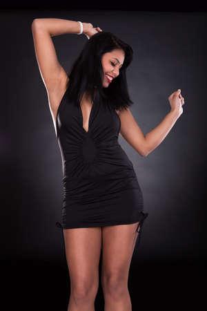 exuberance: Portrait Of Young Beautiful Woman Dancing In Elegant Dress