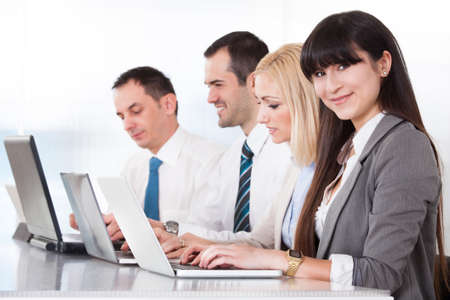 Business People Working On Laptop In Office photo