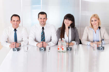 committee: Happy Group Of Business People Sitting In Conference