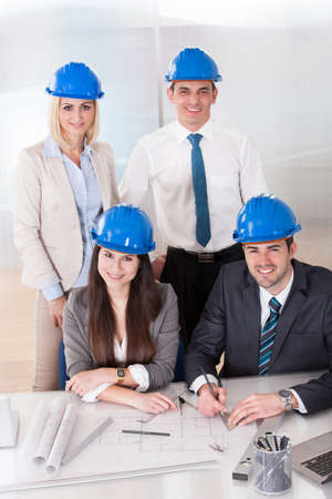 Group Of Architect People Working On Project photo