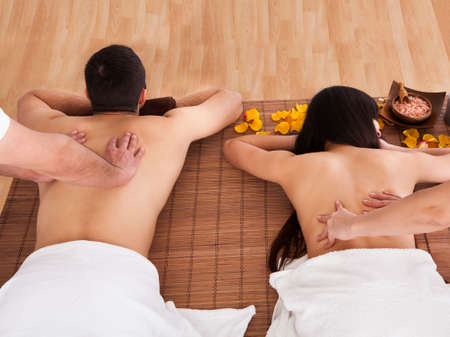 massager: Beautiful Young Couple Enjoying Massage In Spa Centre
