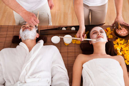 Close-up Of Couple With Face Mask In Spa Centre photo